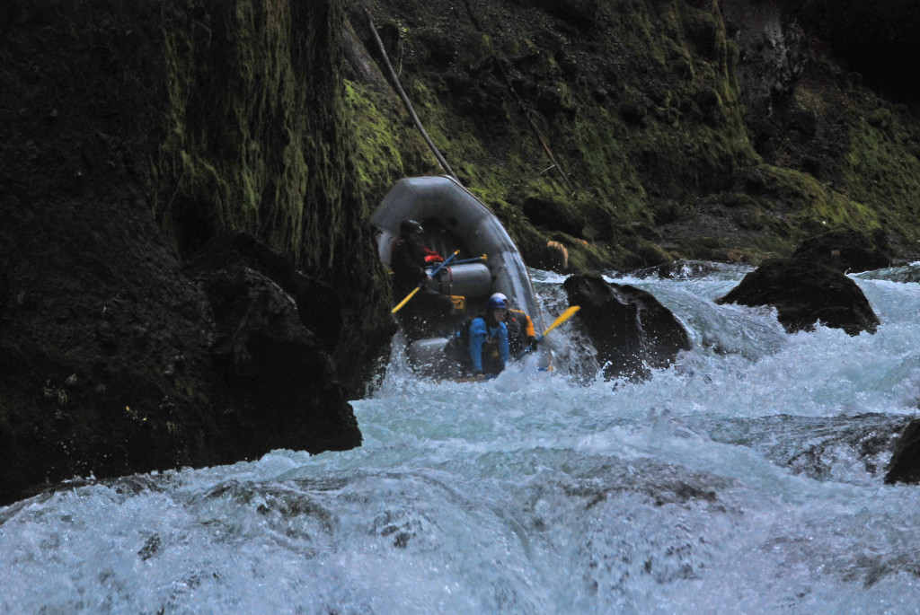 Skip Volpert, Mike, and McCale running a rapid in Takelma Gorge